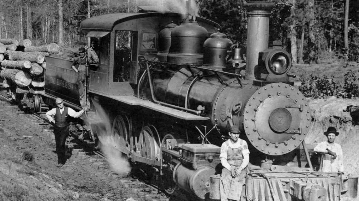1906 Engine #7 and train of 20 cars of pine logs.