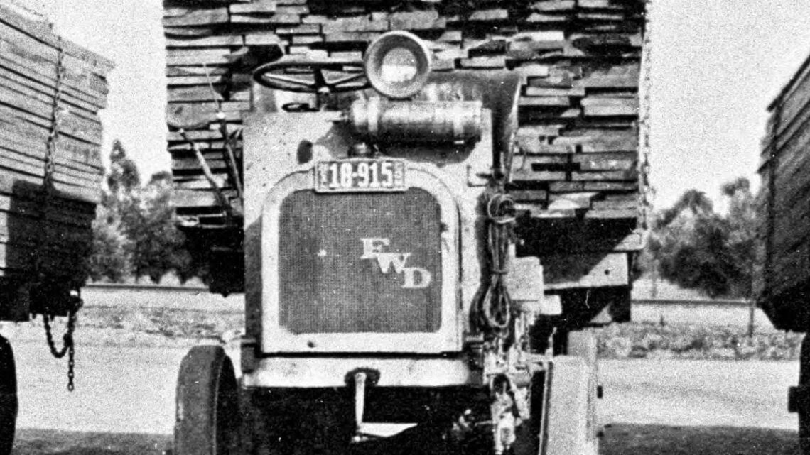 3 lumber trucks loaded, California - 1920 license plates.