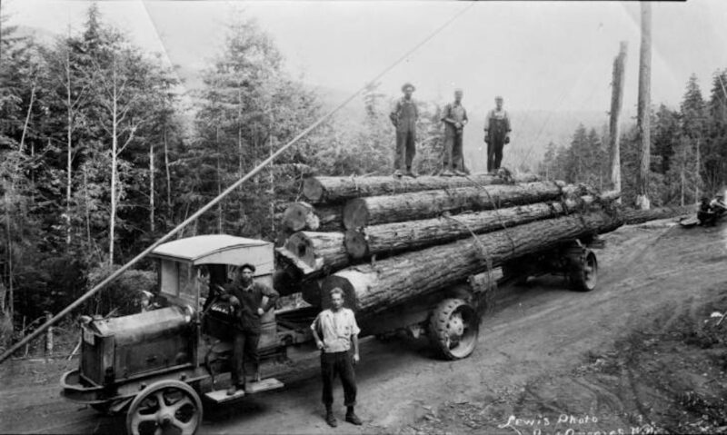 1918 White truck with load of logs.