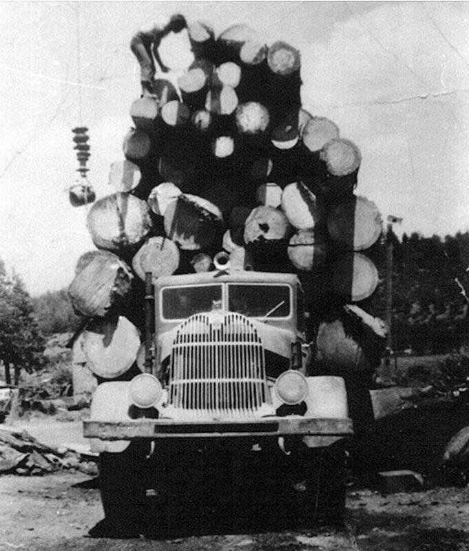 Vintage photo, log loading on a truck.