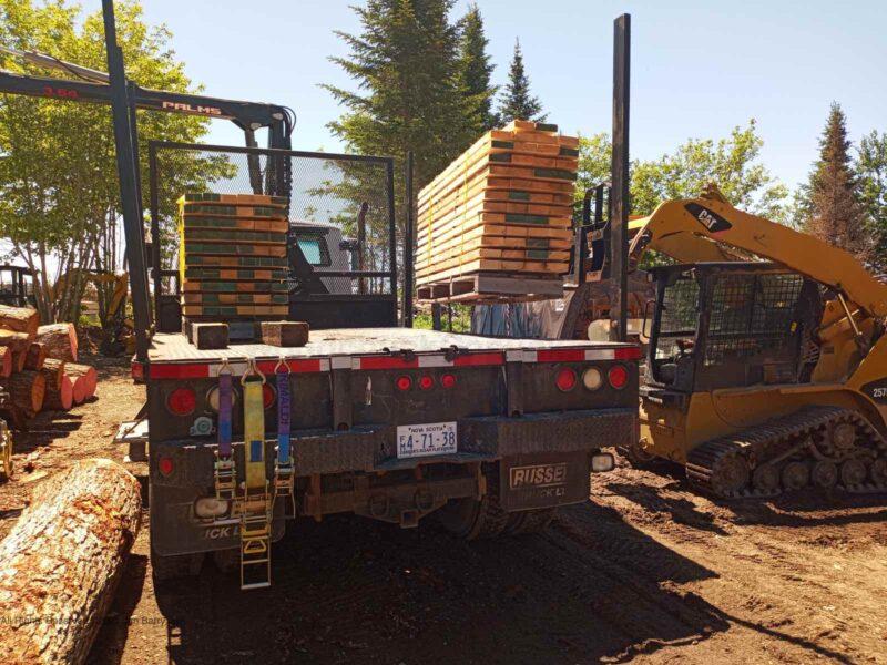 Loading rough sawn lumber in Antigonish County, Nova Scotia.