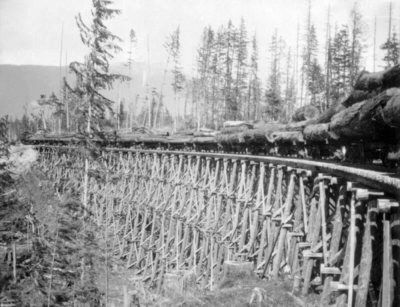 1920s Train on trestle with load of logs.