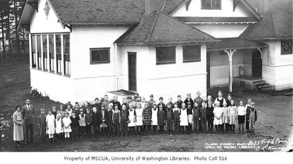 Children and teachers standing outside school building, High Point, WA, USA