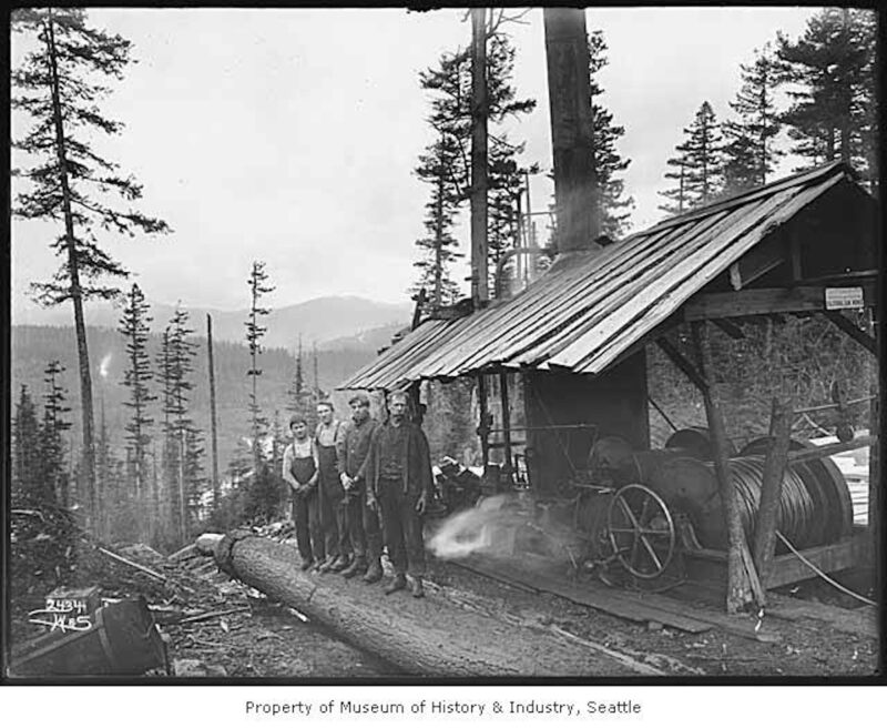 1902 Loggers at the top of a log chute.