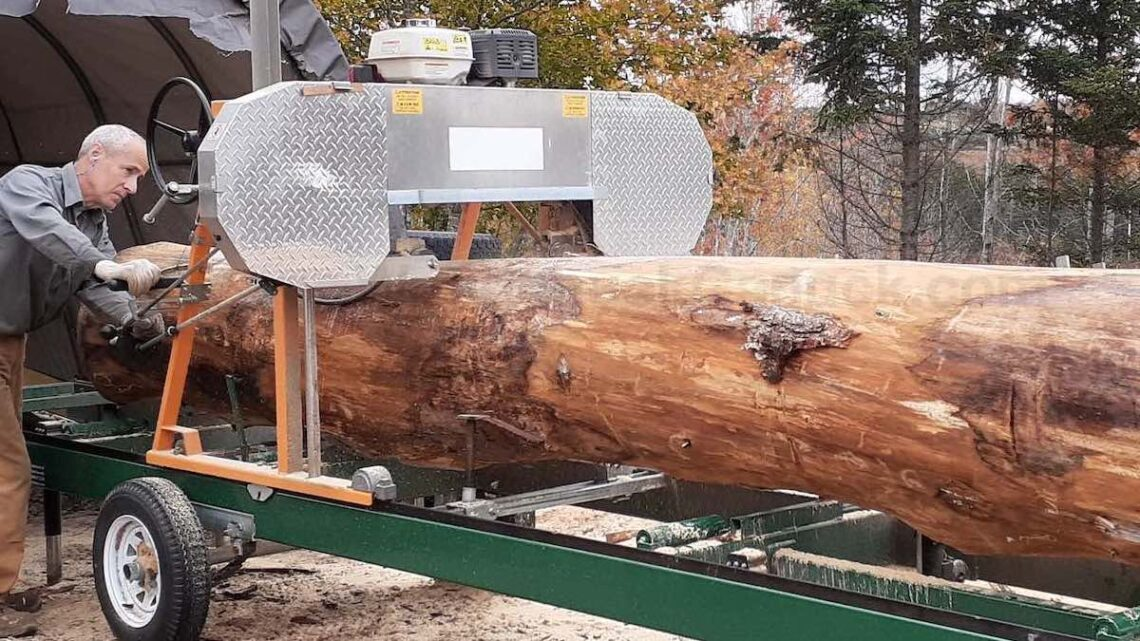 Saw milling large hemlock logs.