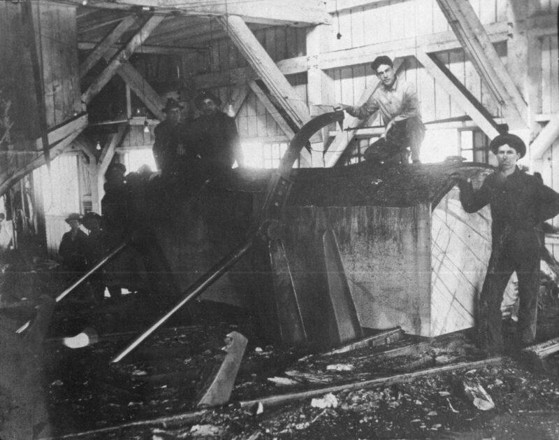 1905 Sawing log in sawmill.